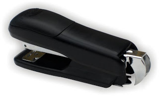 stapler with built-in staple-puller