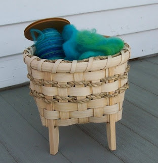 basket with legs, filled with yarn