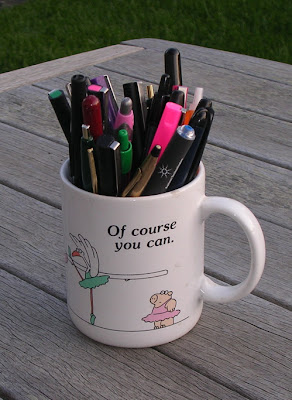 Sandra Boynton mug filled with pens