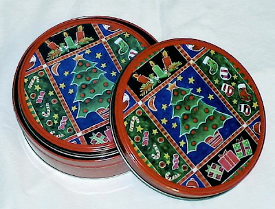 two nesting Christmas tins