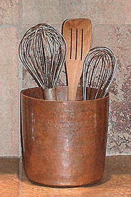 copper utensil jar with whisks and more