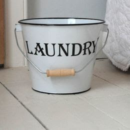 white bucket, says laundry