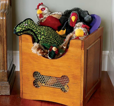 wooden dog toy bin, full of toys