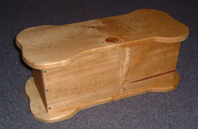 wooden toy box shaped like a bone
