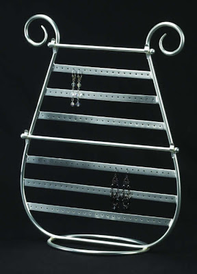 silver earring display, harp shaped