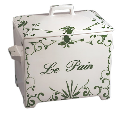 ceramic bread box, white with green letters and decoration; says Le Pain