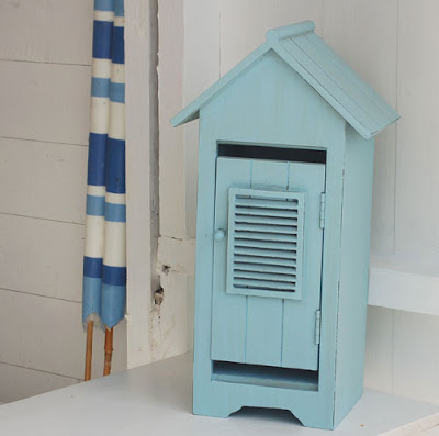 blue beach hut shaped cabinet
