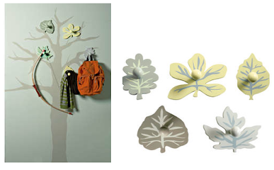 five leaf hooks and tree image on the wall