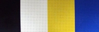 plastic pegboard, four colors: black, white, yellow, blue