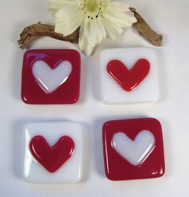 four fused glass heart magnets