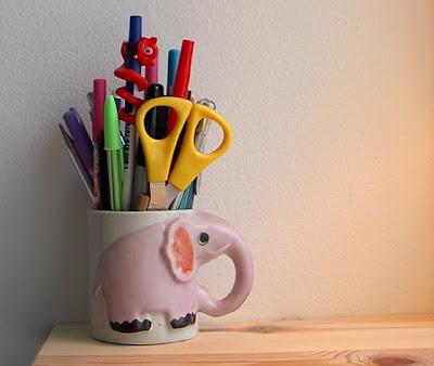 elephant coffee mug holding pens