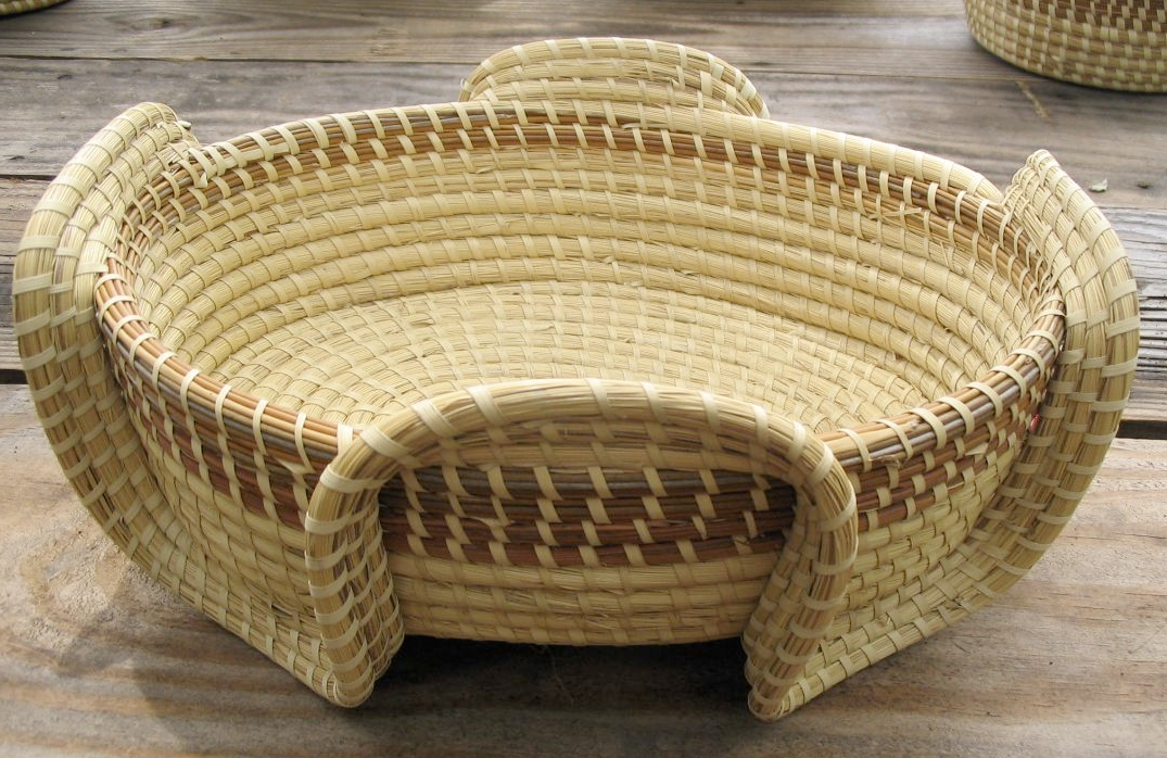 sweetgrass basket Sweetgrass baskets and dry accessories: sweetgrass basket making was brought to south carolina by slaves who came from west africa these functional baskets were used on the plantations and sold for extra income for the slave owners.