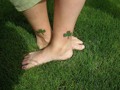 Pictures Of 4 Leaf Clover Tattoos girls tattoos on feet with shamrock tattoo