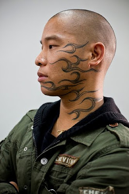 tribal designs,face tattoos