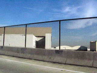 Fence on LAX approach road (c) David Ocker