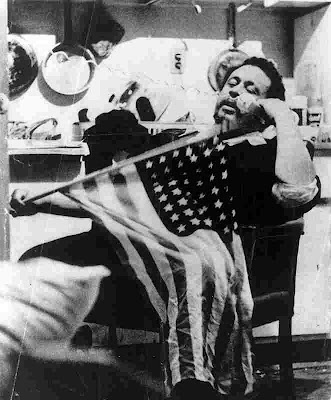 picture of Charles Mingus with flag from mingusmingusmingus.com