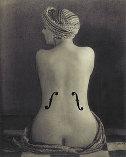 Man Ray - naked woman with f-holes on her back