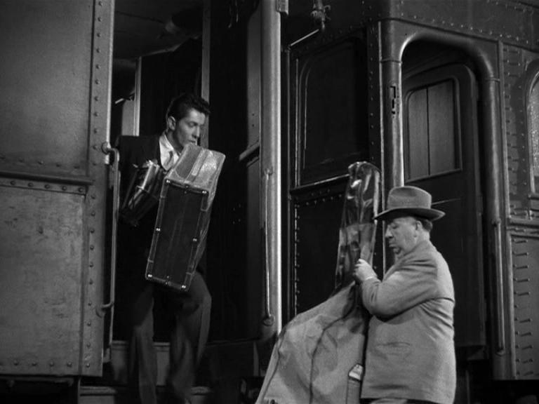 Hitchcock cameo in Strangers on A Train carrying a bass