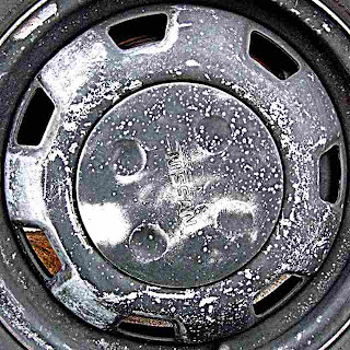 Battered Nissan Hubcap
