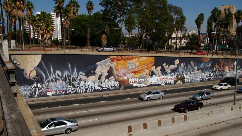 Freeway mural on 101 in downtown Los Angeles defaced with graffiti