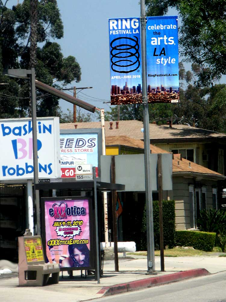 Ring Festival LA banner meets Exxxotica Expo poster on Riverside Drive