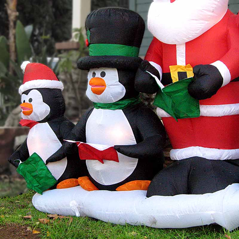 Christmas Penguin - inflated penguins carolling