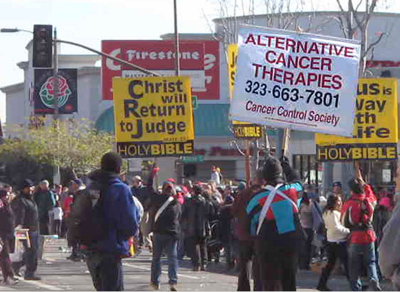 Rose Parade 2011 - Sign carriers are afraid we'll rot in hell