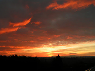 photograph of a fiery winter sunset
