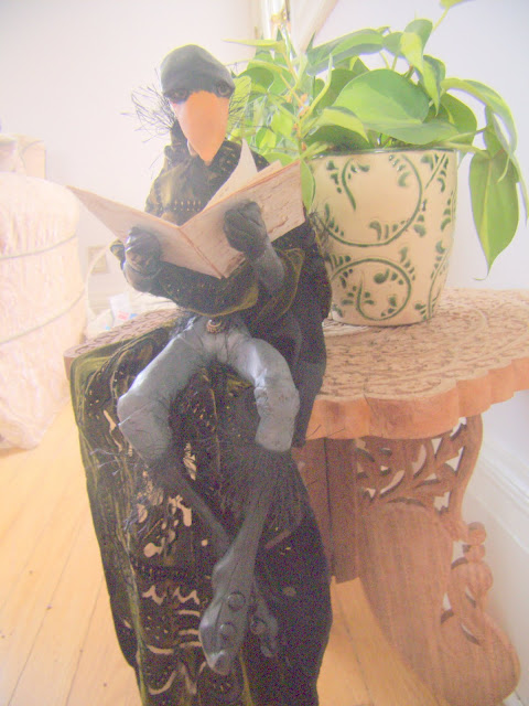 A custom commissioned doll with birch bark book