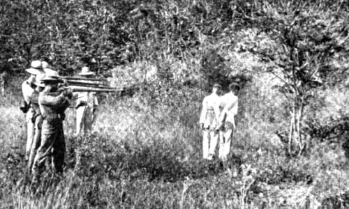 Spanish_firing_squad_executes_2_Filipino_rebels_1896_or_1897