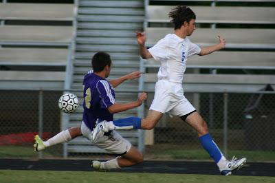 Luke Tomplins outruns Hawk defender