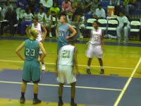 Alex Covington & Tyara Hill wait for the rebound