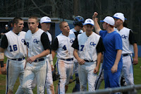 Trojans congratulate Dillon Creech (4) on his game winning hit