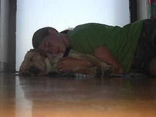 Photo of me snuggled up with Toby on the YMCA's floor (waiting for class to start), Toby's asleep