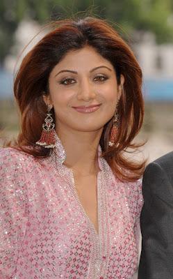 Bollywood actress Shilpa Shetty hot romantic stills gallery