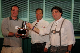 Mike McDonald of Red Brick accepts Governor's Cup from last year's (and 2005) winner, Hugh Sisson of Clipper City Brewing Company.