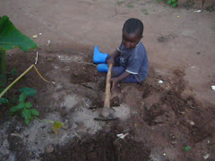 Baby Prince gardening in his boots