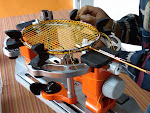 RACKET STRINGING SERVICE