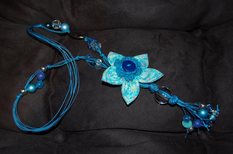 Colar com flor em tecido patchwork e croché