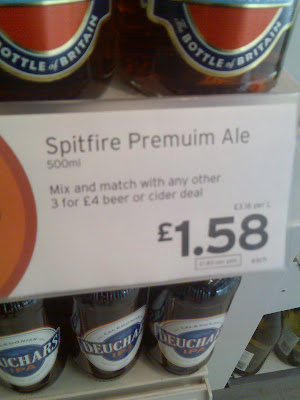 A supermarket price sign for Spitfire Premuim Ale