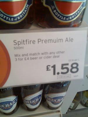 A supermarket price sign for Spitfire Premuim Ale