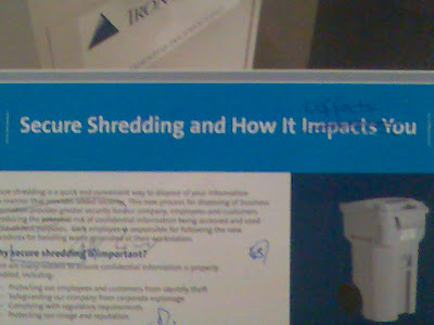A poster on secure shredding with handwritten corrections