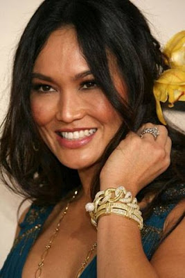 Tia Carrere wearing gold bracelets by Judith Ripka