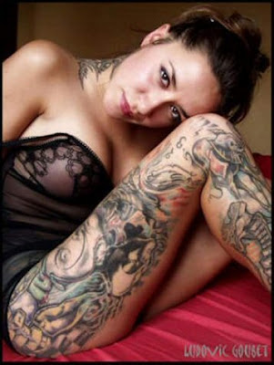 Hot lady with Full body tattoo on legs and neck