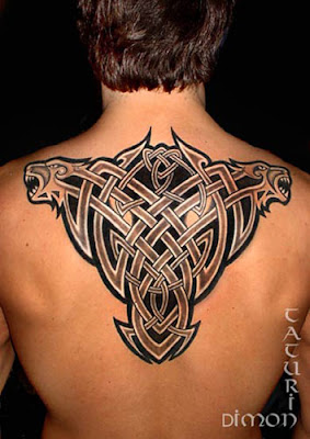 Celtic rib cage tattoo with negative tribal veil