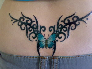 Butterfly with Tribal Tattoo Design on Female Lower Back