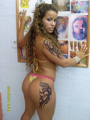 Tribal Tattoo Design on Female Arms and Buttocks