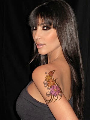 Alyssa Milano Lower Abdomen Tattoo Design · Tommy Lee OM Tattoo and Mayhem