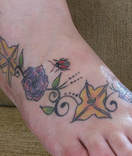 Ladybug Flowers and Leaf Tattoo on Foot