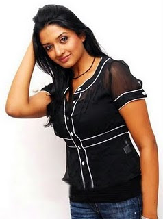 Actress Vimala Raman in Black Top and Designer Jeans